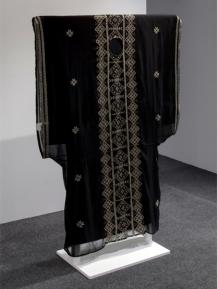 A hybrid of a traditional Kuwaiti dress with Palestinian cross stitch.
